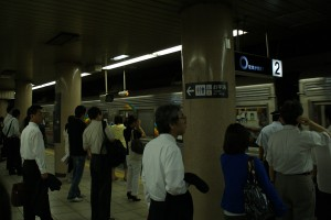 Japanese workers at a Tokyo subway station